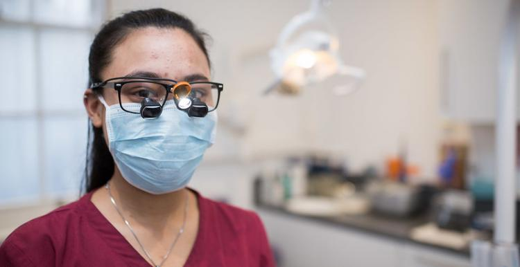 Dentist with face mask