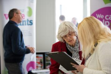 Healthwatch staff member speaking to a member of the public about their experience