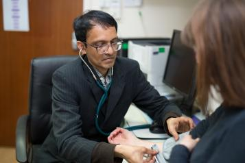 GP and patient in consultation room
